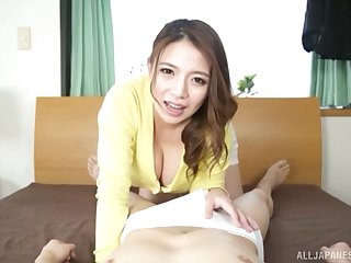 Japanese bombshell Oda Mako exposes her huge tits to the fullest stroking cock