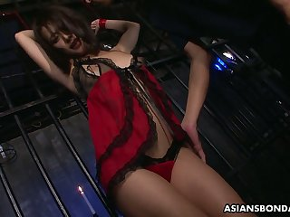 Two dudes fuck Japanese prisoner Yayoi Yanagida with mouth speculum