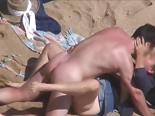 Discrete Beach - Mature couple having it away