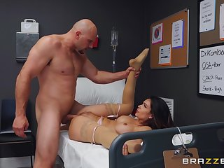 Muscular man fucks the nurse on the clinic bed