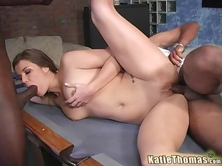 Brunette woman Katie Thomas fucked by two dicks on a pool table