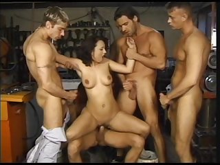 Assertive blonde is being gang banged by several horny studs