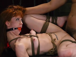 Tight redhead endures a sum total of pain coupled with fucking in BDSM