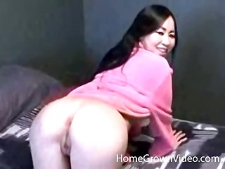 Big mamma Asian amateur fingers the brush hairless pussy