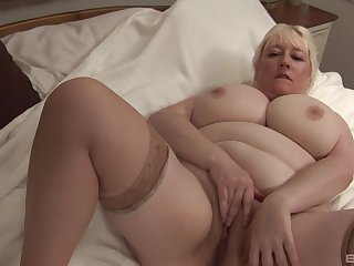 Busty matured blonde amateur gets naked and plays with her cunt