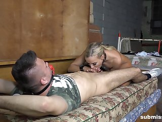 Army man shares some time with a blonde whore