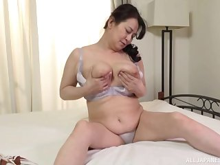 Downcast Japan mature reveals her chubby forms in a hot unequalled