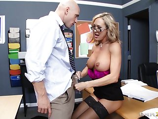 Teacher Brandi Love enjoys pleasuring a stiff dick of her pupil