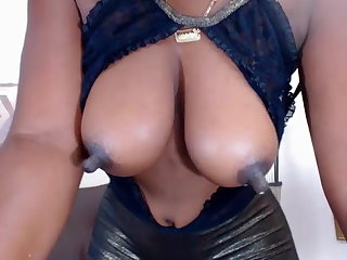 Black mommy has pretentiously long lactating nipples