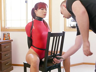 Chairman Bound in Red Thong Bodysuit