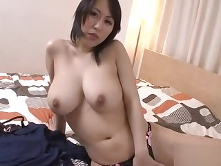 Massive tits Asian stimulates her cunt with lusty insertions