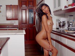 Hot bore Latina Scarlett Camila masturbates in get under one's kitchen